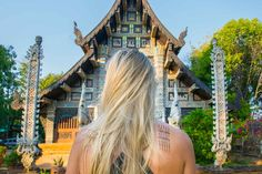 Hannah standing in front of a temple in Chiang Mai with her new Sak Yant Tattoo