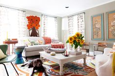 Love the mix of vibrant color and pattern that add eclectic joy to the neutral furniture as a base (assorted pillows and curtains by amazing Textile Designer Erin Flett via: www.erinflett.com/blog)