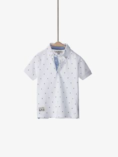 Spring summer 2017 Boys´s PALM TREE DETAIL POLO SHIRT at Massimo Dutti for 19.95. Effortless elegance!