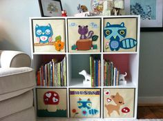 Make your own storage bin decorations: Neutral cubby bins from Target decorated with wool felt, then hand stitched them to give them a more finished look. (Fyi: it is much easier to trace or draw on the back of the felt first before cutting and use a glue gun to adhere.)