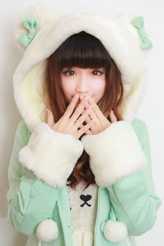 Awesome and adorable mint green coat with white fur trim and white fur hood with ears and bows