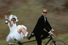 Bride and groom riding tandem