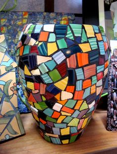 Hmmm - need my buddy Joe to hook me up with broken pieces of Fiestaware - this would make an awesome plant pot.