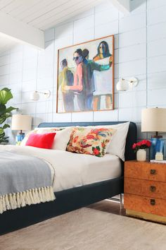 Blue bed, colorful accents and large-scale wall art in Emily Henderson's guest bedroom