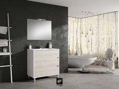 Mueble de baño modelo TAIGA 80cm fondo 45cm 3 cajones con patas. Acabado en fresno. Encimera Extrafina y Espejo Odín, catálogo BATHONE de TORVISCO GROUP.