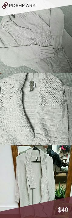 XCVI Cable Knit Cardigan XCVI Cable Knit Cardigan size medium, light gray color, longer in the back, wrap style asymmetrical front, gently used in good condition. Please message me if you have any questions! XCVI Sweaters Cardigans