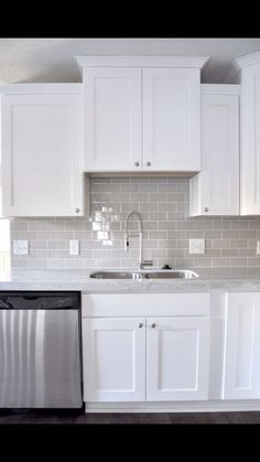 backsplash is gray glass tile MDK