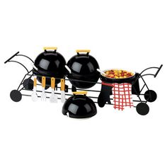 Set out spreads and dips for your next barbecue with this charming condiment server, featuring a grill-inspired design.  Product:
