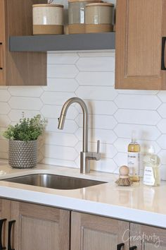 Laundry room sink with white tile backsplash