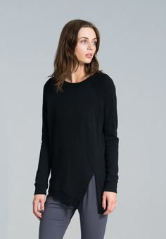 Cozy sweatshirt with a twist. Stylish and unique, made of Italian soft cotton mix, the sweatshirt has a slit on the front and features raglan