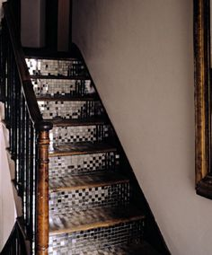 Mirrored Staircase - love the idea of this in an old home, w/ a mix of antique and contemporary furniture.