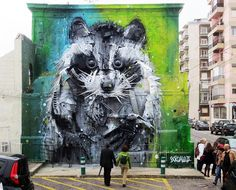 Artist Bordalo II (previously here and here) uses old tires, bumpers, and other scraps of painted found trash to form towering 3D murals of animals on the streets of Lisbon, Portugal.