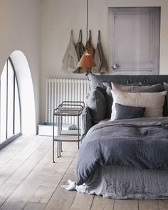 Linen bedding. WANT WANT WANT! I love the idea that a that a headboard could be enveloped in linen and tied at the sides, and the comforter is Devine.