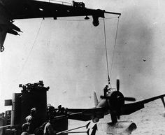 Modern under the wing radar installation on a SC (Curtiss Seahawk) plane. The plane is recovered by USS Chicago (CA 136) after a flight. Photograph released August 14, 1945. U.S. Navy photograph, now in the collections of the National Archives.