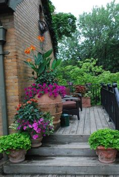 #Patio Pots - tiny porch with big, beautiful flowering containers