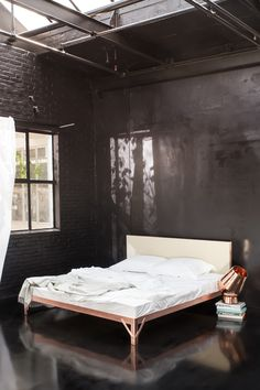 T.D.C | Copper bed by Piet Hein Eek for Yumeko- why do I envisage this place as somewhere one might be tied up in blush pink, silk-lined leather cuffs? Barely any decor but...