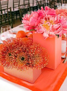Who: Colin Cowie    Location: New York    Most Notable Celebrity Weddings: Rob Mariano and Amber Brkich, Alyssa Milano and David Bugliari, Jean-Georges Vongerichten and Maja Dominique Allen    Our favourite inspiring idea: We love the tropical yet fresh look of these pink peonies paired with orange pincushion proteas placed in modern striped coral vases.