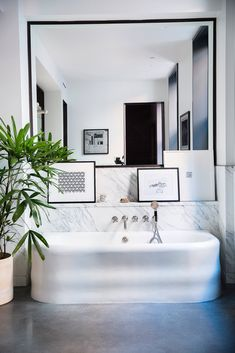 The master bathroom features a Soho tub by Water Monopoly. (Photo: Brittany Ambridge for The New York Times)