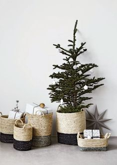 Pretty holiday setting with small tree and woven baskets--image via Katie Armour
