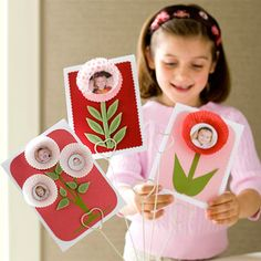 Cut pictures into circles and adhere to inside of paper muffin liners. Cut stems from green paper and attach to cardstock. Have everyone in the family make a card for Mom and place in a card stand.