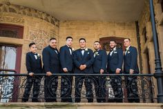 Formal men's wedding attire idea - matching navy blue tuxedos with bow ties and white boutonnieres {Nate Messarra Photography}