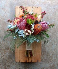 Colorful bouquet attached for wooden plank wedding decor Protea Bouquet, Bouquet Flowers, Protea Wedding, Floral Wedding, Wedding Bouquets, Trendy Wedding, Lily Wedding, Green Wedding, Wedding Favors