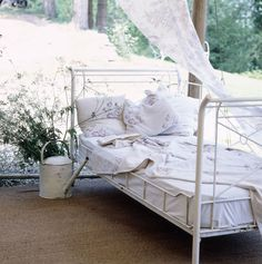 We are thinking this sweet bed makes you feel like you are sleeping in a garden......................