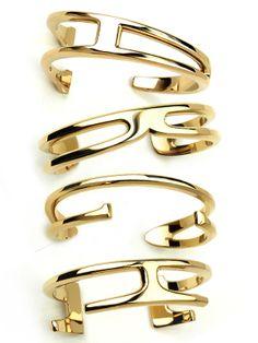 W. Britt's Unwritten collection cuffs: Each takes the shape of a letter (that's A, B, C, and E), but the shapes aren't obvious, so each cuff feels a bit like a sculptural, elegant inside joke. (W. Britt gold cuffs, $295; W and M are $325.)