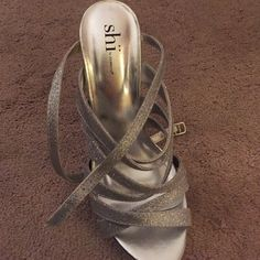 shi strappy silver heels Size 8.5. Worn twice. Sparkly silver. 5 inch heel Shi Shoes Heels