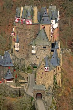 Bur Eltz Castle in Munstermaifeld, Germany | Built in 1157 and considered the German Knights Castle, still remains in the original families possession. It's history is a wealth of myths, events, famous personalities and great Art. By- Photo Place