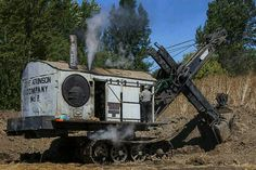 Cable and pulley steam shovel.