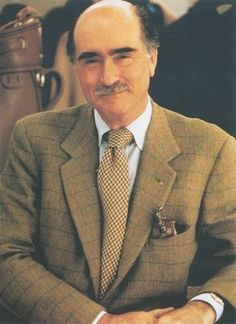 Luciano Barbera in a beautiful tweed coat .