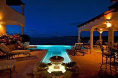An infinity pool beckons to the sapphire-blue seas of the Caribbean from the central patio of this exotic, multi-level villa on the US Virgin Island of St. John. Poised atop a lush hillside, this tropical aerie frames a show-stopping 200-degree panorama encompassing the North Shore, five white-sand beaches, and the pristine landscape of Virgin Islands National Park, a 14,000-acre oasis composed of sub-tropical forest, coastal habitats, and coral reefs.