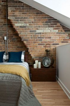 When creating a new attic/loft space, think about keeping a wall of exposed bricks and using it as part of your decoration. Look how stylish it looks against a backdrop of otherwise fairly muted colours - it all works together perfectly.