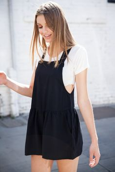 white t-shirt and black overall dress
