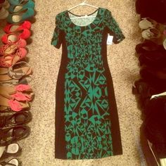 Great longer fitted dress! Cute design. Dress comes to about the knee, BRAND NEW. Nice shorter sleeve that comes to about right above your elbow. Charlotte Russe Dresses