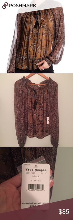 Free People Hendrix blouse NWT. Fits xs/s best.  Tie neck.  Sheer with elastic cuff sleeves.  Measurements happily given upon request!  No trades. Reasonable offers welcome 🍾Note: 20% off bundles of 2+ items in my closet! Free People Tops Blouses