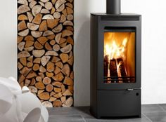 The Westfire Uniq 33 offers everything you look for in a wood burning stove, featuring high efficiency, easy operation and great looks. With its huge glass front you are guaranteed a brilliant view of the fire and with secondary air wash system keeping Double Sided Stove, Stoves For Sale, Wood Fuel, Freestanding Fireplace, Freestanding Stoves, Multi Fuel Stove, Wood Burning Fires, Firewood Storage