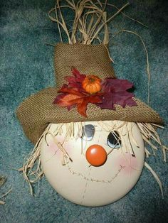 Make a SCARECROW using an old POT LID... love it!!