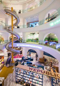 GAD architecture installs giant spiral slide inside istanbul department store