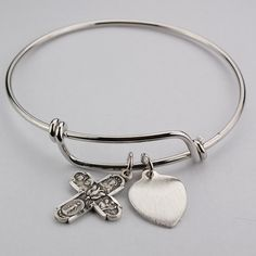 Wear your faith with this newly released 4-Way Medal Bangle Bracelet!  Adult size measures 2.75 inches diameter (across). Youth size measures 2.5 inches.