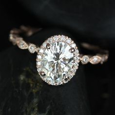 """The vintage-inspired """"Gwen"""" ring, from Rosados Box on Etsy, puts the spotlight on moissanite and diamonds and is set in 14k rose gold."""