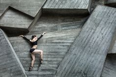Graceful ballerina - Graceful ballerina on the background of the concrete urban…