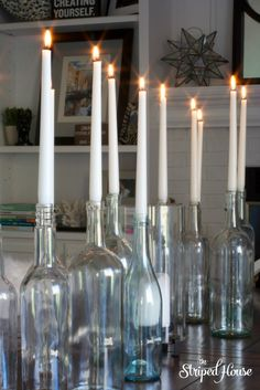 Put those empty wine bottles to use as centerpieces. Festive and romantic!