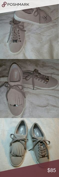 MICHAEL Michael Kors Suede Sneakers New w/o tags w/o box MICHAEL Michael Kors cement suede sneakers with removable fringe flaps. Leather upper, rubber outsole. Both flaps included but I removed it from one shoe to show both styles. Beige color. MICHAEL Michael Kors Shoes Sneakers