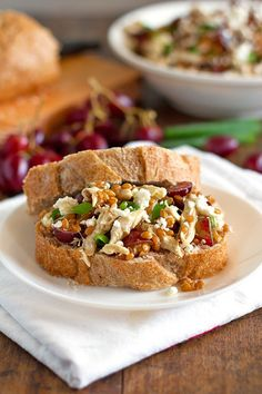 This honey chicken salad with grapes and feta is fresh and simple. Includes chicken, feta, red grapes, wheat berries, and honey lemon dressing.