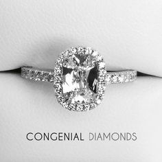 Antique inspired diamond engagement ring set with a cushion cut diamond