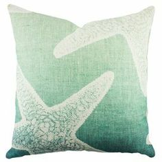Handmade in the USA, this charming cotton denim pillow showcases a starfish motif in blue and white.  Product: PillowConstruction Material: Cotton denim coverColor: Blue and whiteFeatures:   Insert includedZipper enclosureMade in the USA Cleaning and Care: Dry clean
