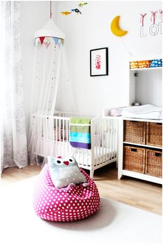 White nursery with pops of color. This looks more like something I could actually do.