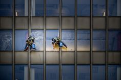 Workers - Fast and precise workers suspended in the air, Chicago Illinois